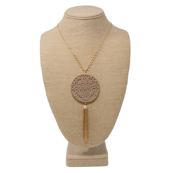 "Long gold tone necklace with filigree pendant and metal tassel. Approximately 32"" in length with a 2.5"" pendant and 3"" tassel."