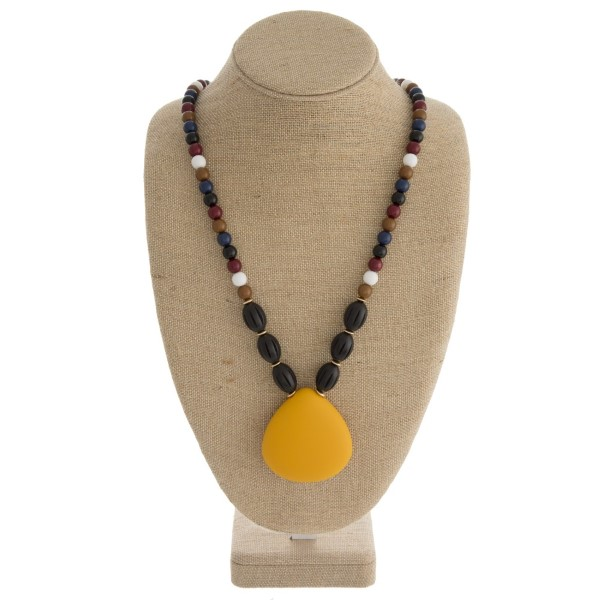 """Long statement necklace with acrylic beads and matte teardrop pendant. Approximately 32"""" in length."""