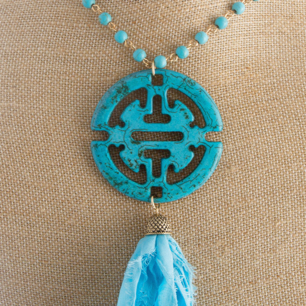 """Long faceted bead necklace with boho pendant and soft tassel. Approximately 30"""" in length."""