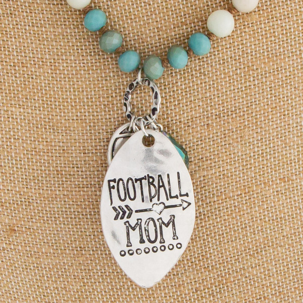 "Long beaded ""Football Mom"" necklace with beaded earrings. Approximate 30"" in length with 2.5"" pendant."