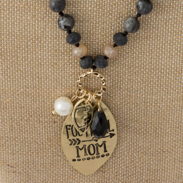 "Long beaded necklace with football mom pendant. Approximately 30"" in length."