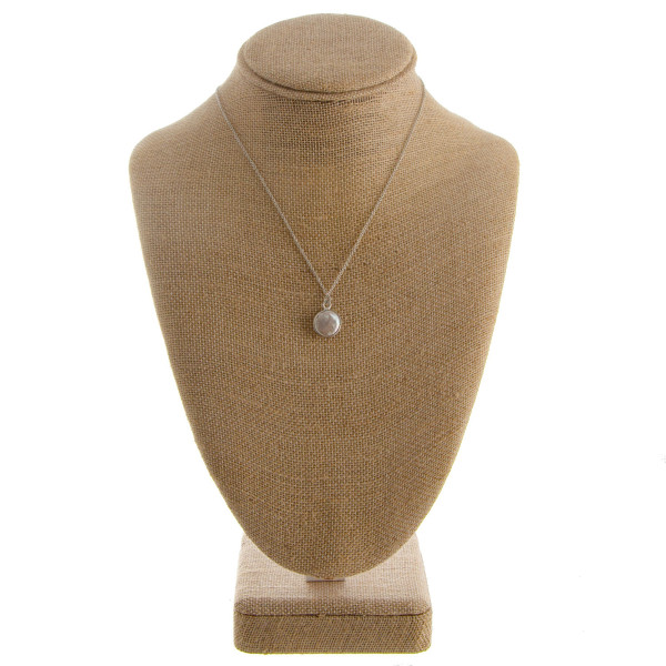"Long metal necklace with natural stone. Approximate 20"" in length with .5 pendant."