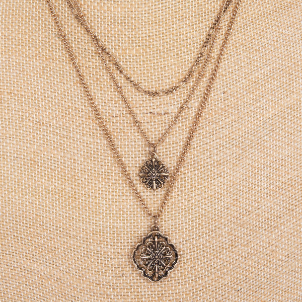 "Layered metal necklace with boho charm. Approximately 16-18"" in length."