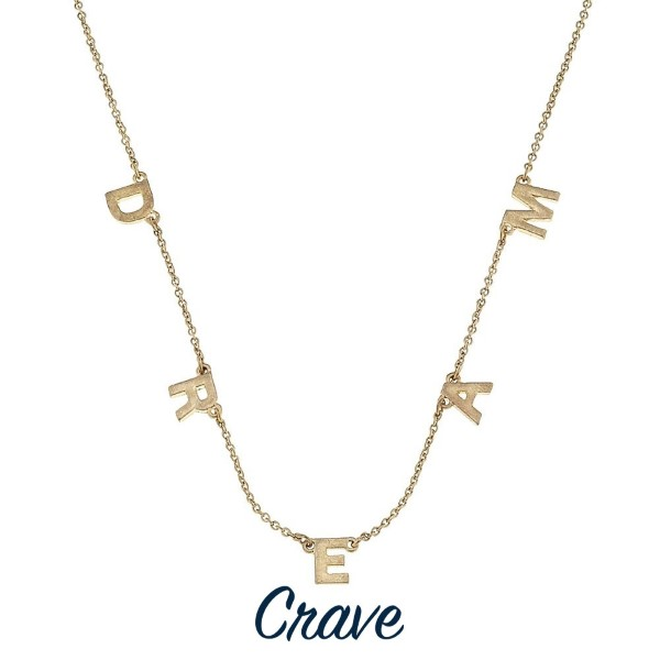 "Short gold tone necklace with charm detail. Approximately 16"" in length."