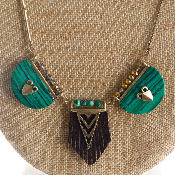 "Long bronze boho style necklace with arrow charms.  Approximate 32"" in length"