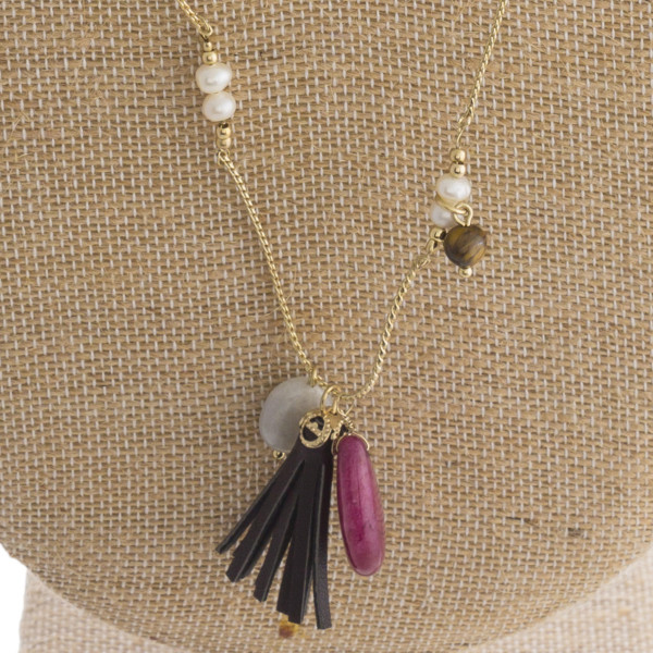 Long metal necklace with beads and tassel details.