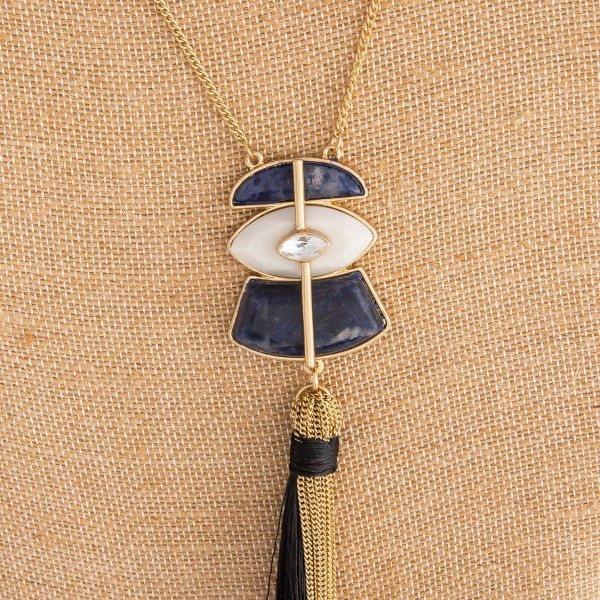 "Beautiful gold necklace with tassel pendant. Approximate 30"" length. with 1.5 pendant."