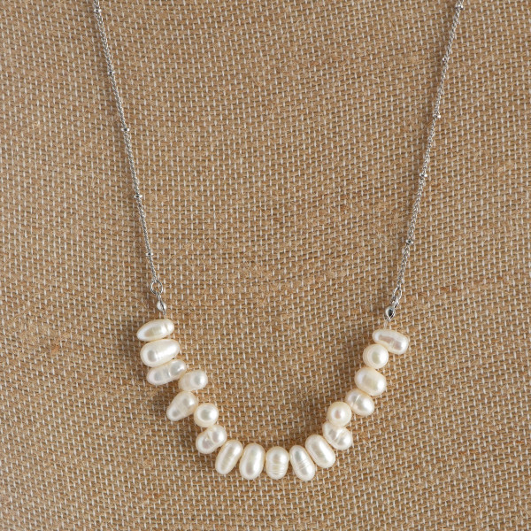 "Long pearl necklace. Approximate 24"" in length."