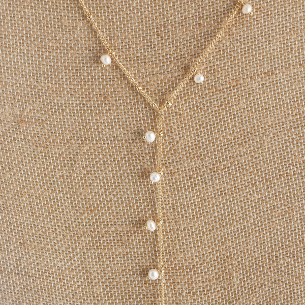 "Long layered necklace with pearls. Approximate 32"" in length."