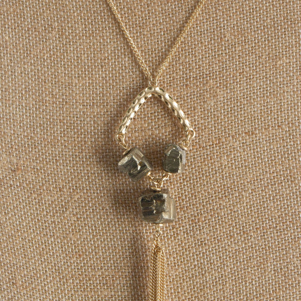 """Long gold neckless with stone and tassel details. Approximate 34"""" in length with 5"""" pendant."""