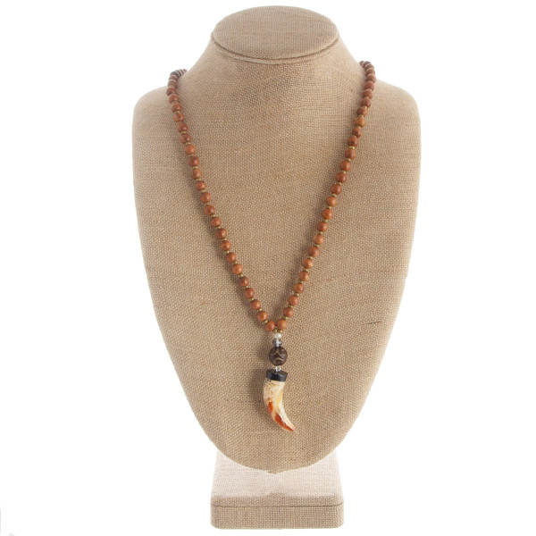 "Long wood beaded necklace with horn pendant. Approximate 40"" in length with 2.5"" pendant."