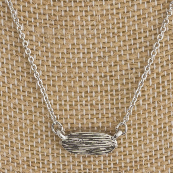 "Short metal necklace with oval focal. Approximately 16"" in length."
