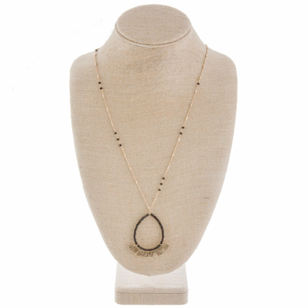 """Gorgeous drop metal necklace with beaded detail. Approximate 36"""" in length and 2.5 in pendant."""