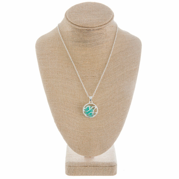"Beautiful long metal neck with caged  ""Ocean wave"" pendant with natural stone. Approximate 18"" in length with 1"" pendant."