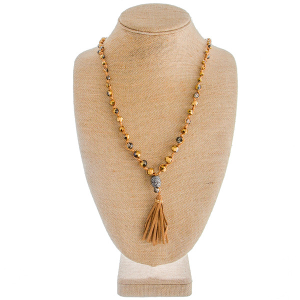 """Beaded necklace and earring set- Includes long beaded necklace with rhinestone and tassel details. Approximate 38"""" in length and 3.5 in pendant."""