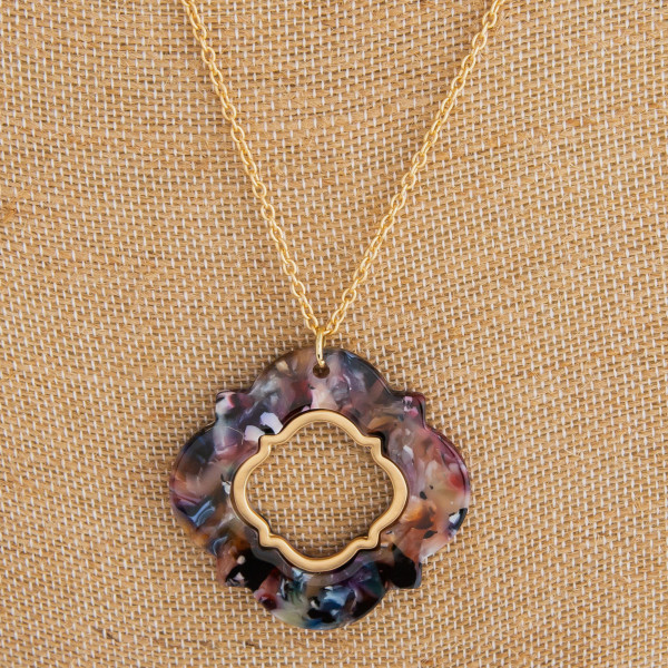 """Long gold metal necklace with acetate clover earrings and pendant.  Approximate 32"""" in length with 2"""" pendant."""