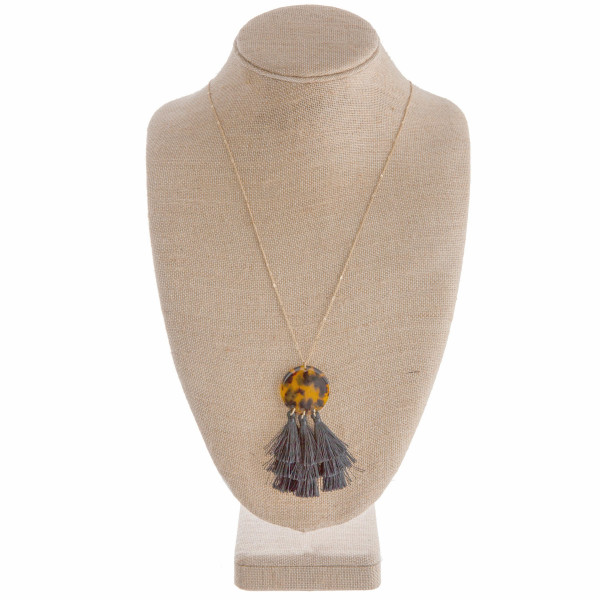 """Long gold necklace with acetate pendant with tassels. Approximate 34"""" in length with 4"""" pendant."""