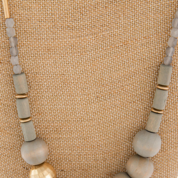 "Long metal necklace with bead details. Approximate 28"" in length."