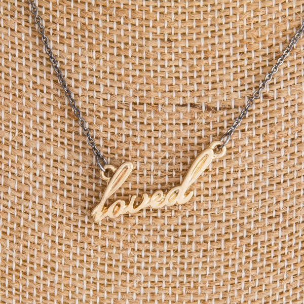 "Gorgeous long metal ""loved"" Necklaces. Perfect for everyday wear. Approximate 16"" in length with 1"" pendant."