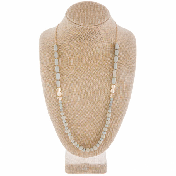 "Long necklace with gold links and beads with some natural stone. Approximate 32"" in length."