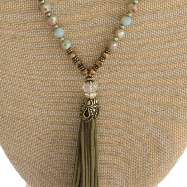 "Long metal necklace with beads and tassel pendant. Approximate 27"" in length."