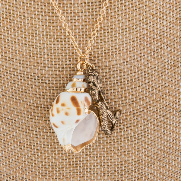 "Medium length metal necklace with sea shell pendant. Approximately 18"" in length."