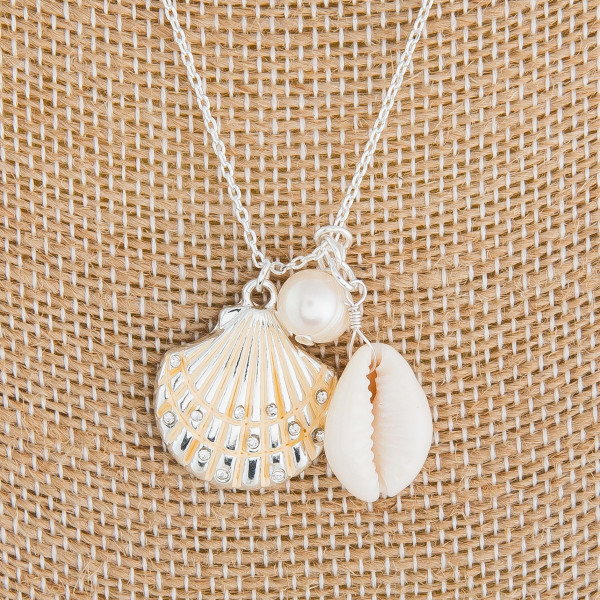 "Medium length metal necklace with seashells and sea life details. Approximately 18"" in length."