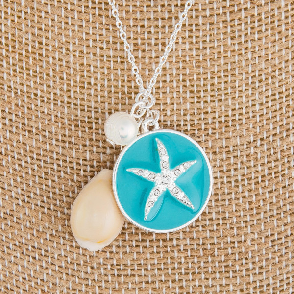 "Medium length metal necklace with regular and puka seashells accented with sea life details. Approximately 18"" in length."