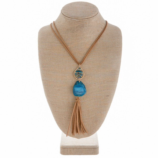 """Long leather necklace with drop pendant with beads and natural stone with tassel. Approximate 27"""" in length."""