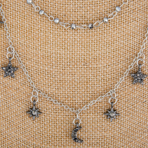 """Long layered metal earrings with moon and star charms. Approximate 24"""" in length."""
