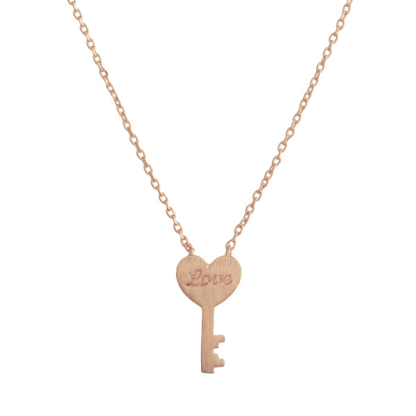 "Metal necklace with small key pendant engraved with ""Love."" Approximate 20"" in length with 0.5"" pendant."