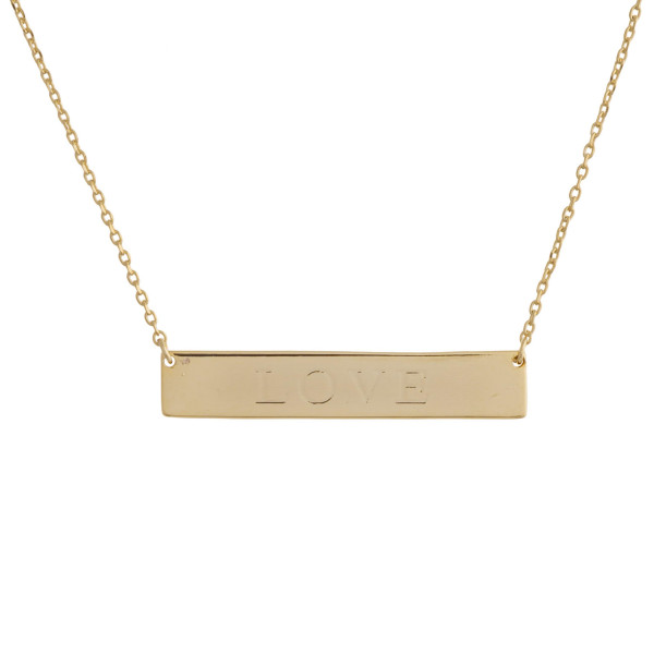 "Gold dipped necklace with bar pendant engraved with message, ""Love."" Approximate 16"" in length with 1"" pendant."