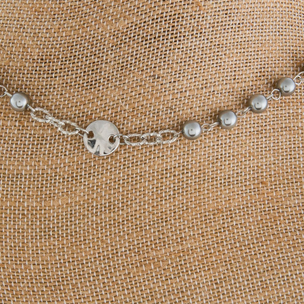 """Long metal necklace with pearl detail. Approximate 32"""" in length."""