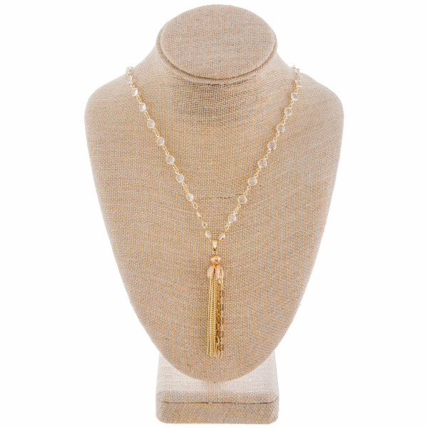 """Long metal necklace with some acetate details with tassel pendant. Approximate 30"""" in length."""
