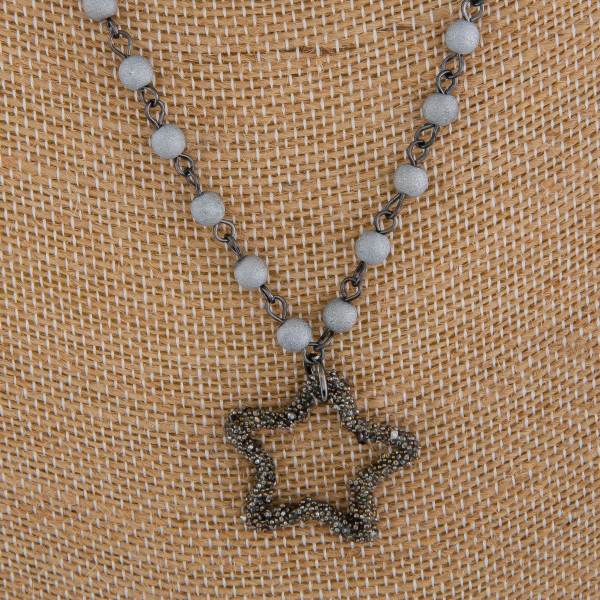 """Long beaded layered necklace with star pendant. Approximate 28"""" in length."""