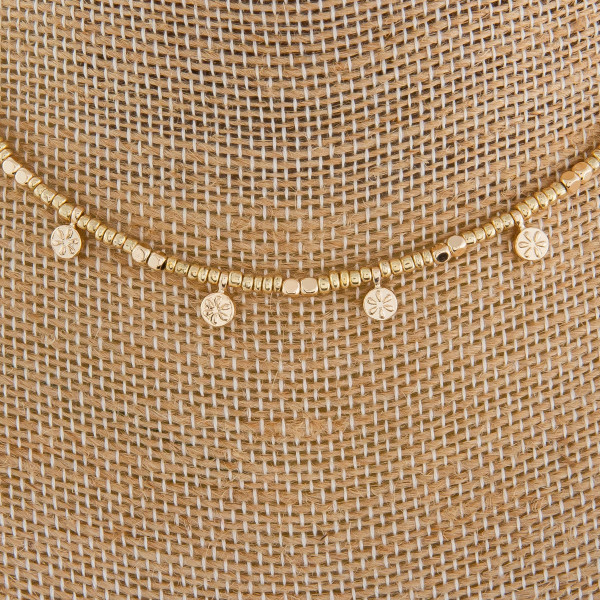 """Short metal beaded necklace with small charm details. Approximate 10"""" in length."""