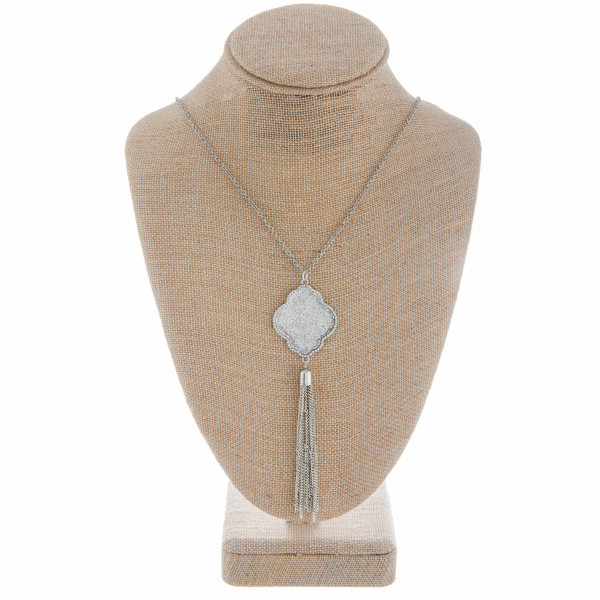 """Long metal necklace with rhinestones and pendant with tassel. Approximate 36"""" in length."""