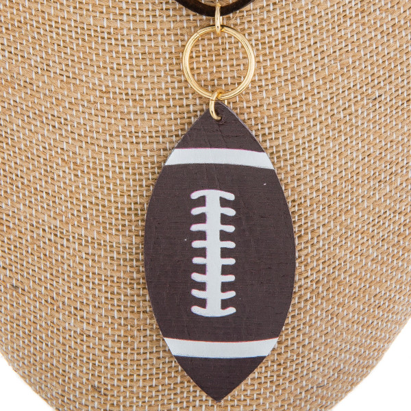 """Long faux leather necklace with football pendant. Approximate 28"""" in length."""
