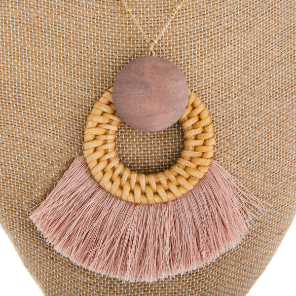 """Long metal necklace with wood and tassel details. Approximate 38"""" in length."""