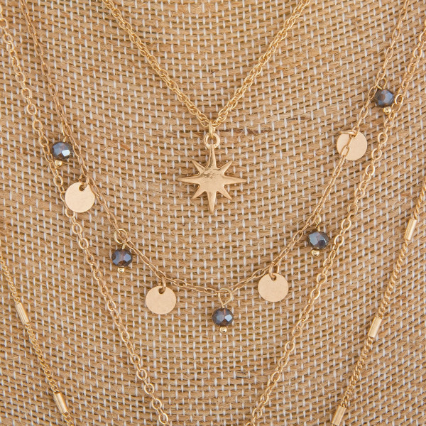 """Long metal layered necklace with charms and cross pendant. Approximate 30"""" in length."""