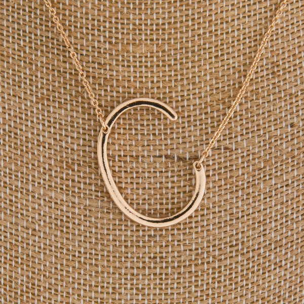 """Long gold necklace with initial charm. Approximate 16"""" in length with 1.5"""" pendant."""