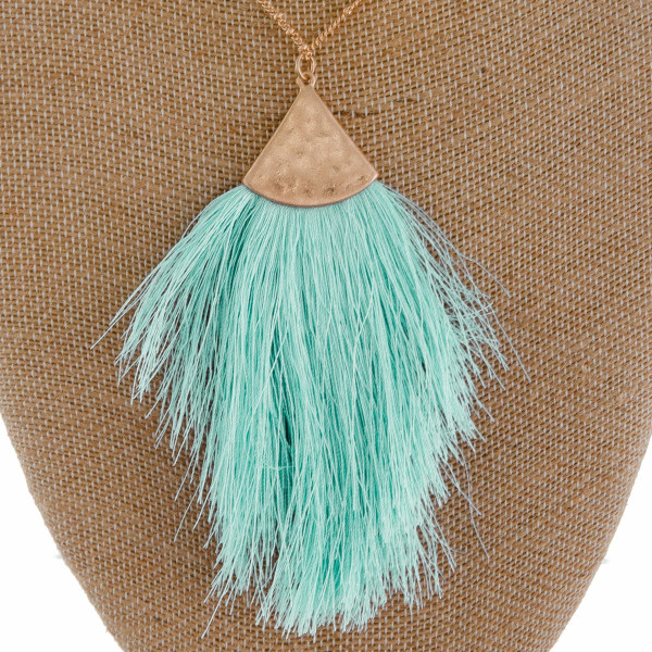"Long metal gorgeous necklace with fanned tassel pendant with leather detail. Approximate 40"" in length. with 3.5"" pendant."