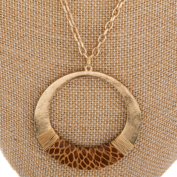 "Long metal gorgeous necklace with hoop and leather snake skin details pendant. Approximate 20"" in length. with 2"" pendant."