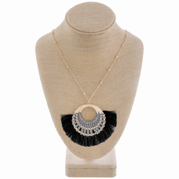 """Long metal gorgeous necklace with fanned tassel pendant with leather detail. Approximate 40"""" in length. with 2"""" pendant."""