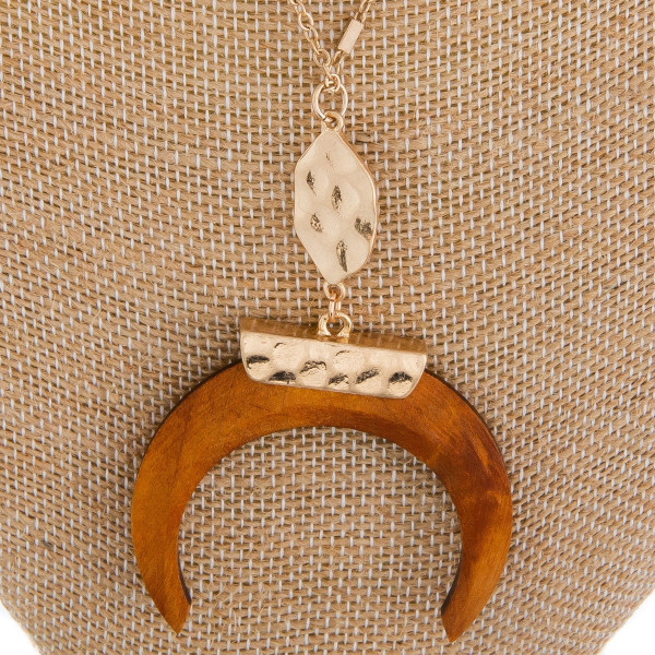 "Long metal gorgeous necklace with wood horn pendant. Approximate 40"" in length. with 2"" pendant."