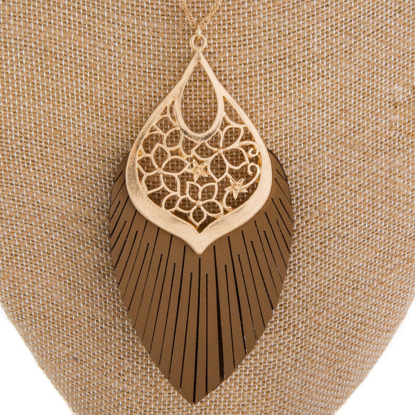"""Long metal gorgeous necklace with leather tassel pendant with leather detail. Approximate 40"""" in length. with 3.5"""" pendant."""