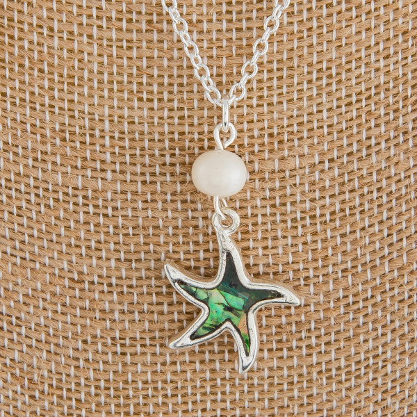 """Long metal necklace with beach pendants. Approximate 18"""" in length."""