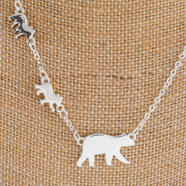 """Long metal Mama Bear necklace. Approximate 18"""" in length."""