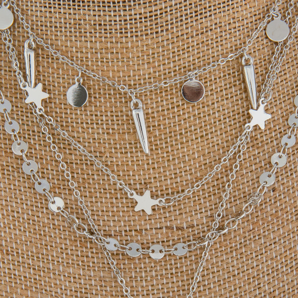 """Long metal necklace with charms and moon pendant. Approximate 16"""" in length with 1"""" pendant."""