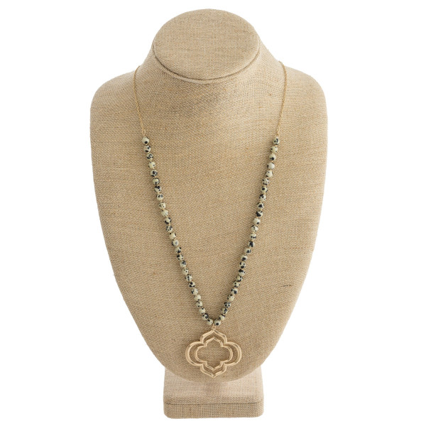 "Long metal necklace with natural stone and clover pendant. Approximate 32"" in length."